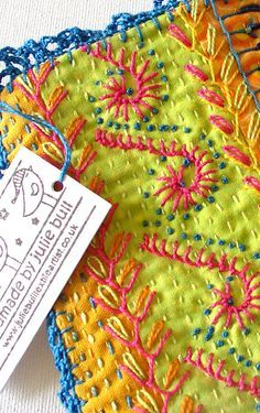 Other hand embroidery stitches in the foreground, kantha stitches in the background ...