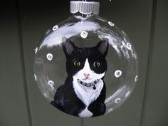 4 glass ornament with black and white cat,Swarovsky crystal collar.Send us a picture of your kitty and we will create a forever memory for you.We also paint wildlife and any domestic animal.$25.00 for custom orders.Ornaments come giftboxed.