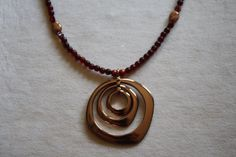 Hey, I found this really awesome Etsy listing at https://www.etsy.com/listing/242321448/red-garnet-and-copper-pendant-necklace
