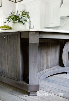 Pretty Kitchen in Quiet Colors | Traditional Home l Dana Wolter Interiors #island #reeded #waxedwood