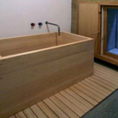 Tub made from compacted dirt. (rammed earth construction)