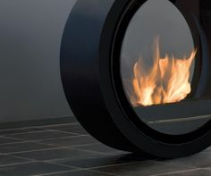 Noble designer fireplace ROLL FIRE available in the online shop of Conmoto.