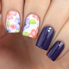 """Watercolor Floral Nail Art (PackAPunchPolish) (""""For the white watercolor floral base I used Motives Wedding Dress. For the purple nails I used China Glaze All Aboard. The flowers were done with Apple Barrel acrylic paint by Plaid. The glitters on the purple nails are from Born Pretty Store. I also used two different top coats for this design. I went with Butter London's Matte Finish top coat for the floral and then Lauren B Beauty's Gel-Like top coat for the others."""")"""