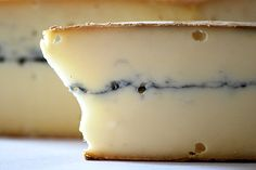 Morbier is an aromatic and surprisingly mild French cow's milk AOC cheese defined by the dark vein of vegetable ash streaking through it middle. Today, the ash is purely decorative, a nod to the method by which Morbier was once produced in Franche-Comté. Medium. | Artisanal Cheese