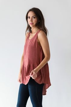 • Brick colored peplum waist ruffle tank top • Available in S, M, L. Model is wearing a size small • 100% Rayon