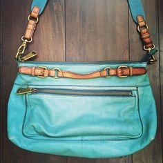 Fossil Explorer Leather Satchel Amazing turquoise Fossil Leather Explorer Crossbody Satchel! Very good pre-owned condition with a few minor wear spots that are normal with leather use. Beautiful vibrant turquoise color, adjustable crossbody strap, tons of pockets! Roomy enough to hold iPad, small notebook, plus all your essentials! Fossil Bags Crossbody Bags