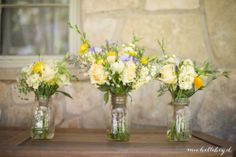 Wild flower theme wedding with burlap and mason jars. Beautiful vision from the bride brought to life by Mercedes Flowers.  Michelle Boyd Photography