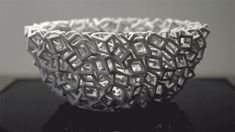Blooms are 3-D printed sculptures designed to animate when spun under a strobe light.
