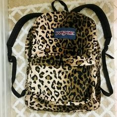 "Fuzzy! Cheetah Print Jansport Backpack Great pre-owned condition, no tears or stains, etc.  Front utility pocket with organizer and one large main compartment. Padded back panel and straight-cut, padded shoulder straps. Web haul handle.  Large, 16.7"" x 13"" x 8.5""?can fit a TON of stuff! Jansport Bags Backpacks"