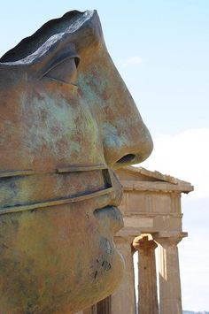 Agrigento Valley of the Temples ,  blossoming of the almond, and Mitoraj sculpture,  Agrigento, Sicily, Italy