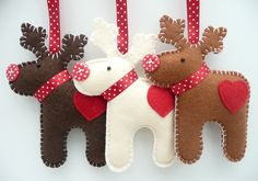 love these little guys.....Reindeer Felt Hanging Decorations x3. £17.50, via Etsy.
