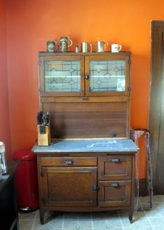 This would be a great way to restore my old hoosier cabinet... replace the top panels with glass and replace the countertop with granite or marble...