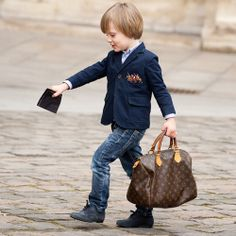 Omg @Lori Arnold check out this little boy... when will Penn get his first Louis bag? :)