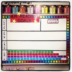 The A.R. Goal board I made for my classroom. Each student has their name on a small laminated piece of paper. On the back I put magnetic tape so the names could easily be moved. The names are color coded by class.   Each week as a class we look at goals, and students get to move their name up as they get closer to their goal.