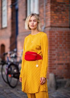 Lisa Hahnbueck wearing yellow Samsoe Samsoe suit Chanel belt bag Chanel slippers seen during the Copenhagen Fashion Week Spring/Summer 2019 on August...