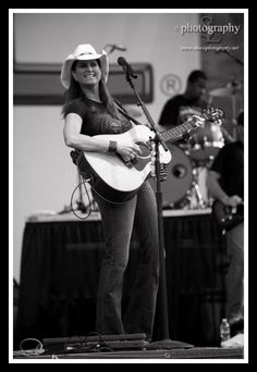 Terri Clark ~ she's pretty and a great singer songwriter and guitar player