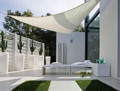 Modern white outdoor space. I would replace those cacti with buxus