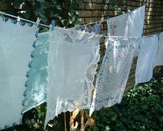 """""""Old, but gold"""".   clothes line...yes, but where? In back, to right of eventual path into the shadier part of back.  watch the pattern of the sunlight and shade.  select a spot that is bright and sunny, but not dominating the space."""