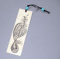 Zentangle: by Pat Ferguson, CZT. She uses mat board scraps to make these bookmarks. After tangling them, she sprays them with a protective coating.