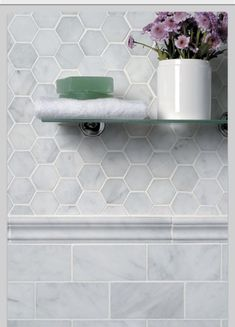 Classic clean hex tile with rectangular tile to contrast (just the subway tile up to the bullnose in the regular walls; hex tile upper in shower area)