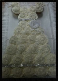Cupcake wedding dress. Great idea for a shower. Check it  out @ Gianino's Pastries https://www.facebook.com/GianinosPastries?ref=stream