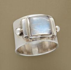 """GLACIER RING -- A Himalayan glacier inspired the choice of icy moonstone, locked in polished sterling silver. A handcrafted exclusive. Whole sizes 5 to 10. 1/2""""W."""