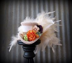 Bohemian flower Micro Mini Top Hat,  Alice in Wonderland, Mad hatter Hat, Tea party mini top hat, bridal shower, Ivory Mini Top Hat by ChikiBird on Etsy https://www.etsy.com/listing/211097466/bohemian-flower-micro-mini-top-hat-alice