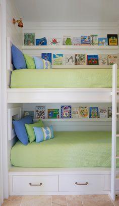 Bunk room with with sleek floating bookshelves.