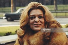 Greek actress Melina Mercouri pictured posed wearing a fur coat on Park Lane, London in March 1971 Irene Papas, London In March, Crazy Girls, Picture Poses, Movie Stars, Swimming Pools, Fur Coat, Greek, Actresses