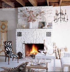 White Fireplace...I want to paint our rock fireplace white.  Will that really look bad?  Hubby and I are having a bit of a time coming to agreement on it!