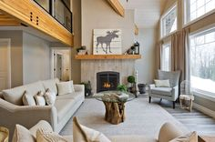 Great room with modern style fireplace. Glu-lam Douglas Fir beams rise up to the loft with glass railings. Antler Trail great room http://www.linwoodhomes.com/house-plans/plans/antler-trail/