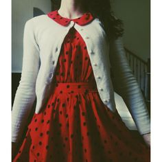 Red, polka-dotted, Peter pan-collared dress with white cardigan. I love how the collar is tucked OVER the cardigan.