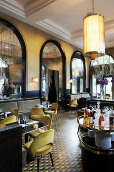 Restaurant Interior Ideas: With a gorgeous color palette, geometric patterned floors and rich materials like the beautiful mustard yellow velvet chairs, warm brass, smoky mirrors and dark woods, Le Flandrin is now a more sophisticated and chic restaurant!   Inspiration & Ideas #restaurantinterior #restaurantinteriorddesign #restaurantinteriorideas Find more here: https://www.brabbu.com/en/inspiration-and-ideas/world-travel/restaurant-interior-ideas-flandrin-paris