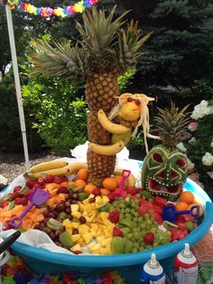 DIY.  Party. Luau Party.  Fruit Tray Display.  Pineapple Tree.  Fruit Monkey.  Tiki Watermelon Carving.