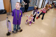 Woonsocket Area Career and Technical Center's preschool education class held a Mardi Gras parade last Friday. Preschool students decorated their trikes, shopping carts, scooters and themselves in purple, gold and green for the special occasion and th . This is just perfect for my baby. More baby items here:  http://adriankmarketing.com/products/?cat=25