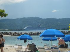 At the beach we went to in Jamaica, you can see our ship in the background