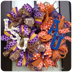 LSU AUBURN HOUSE DIVIDED FOOTBALL WREATH. More wreaths can be found on my Facebook page: www.facebook.com/CraftsandCreationsByTerri or go to my Etsy page https://www.etsy.com/shop/CreatedByTerri