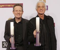 John Paul Jones and Jimmy Page from Led Zeppelin show their lifetime achievement awards tonight in Berlin
