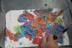 For little hands: Fill a shallow dish full of baking soda. Then give the kids colored vinegar and droppers--fizzy, bubbly fun