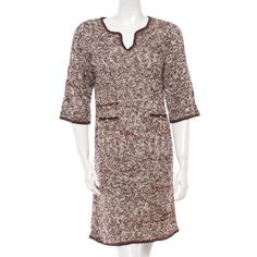 Chanel Knit Dress NWOT Brown and beige Chanel knit dress with braided CC logo at waist pocket, three quarter sleeves with navy blue trim and gold Chanel buttons. Fits medium to large due to knitted fabric. There is also a navy slip that goes underneath. CHANEL Dresses