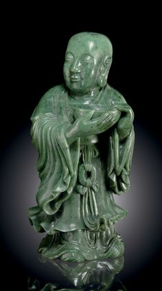 A LARGE SPINACH-GREEN JADE FIGURE OF A STANDING ATTENDANT - China