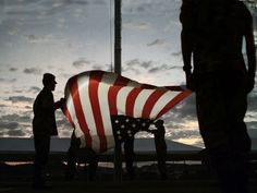 Soldiers Folding Flag