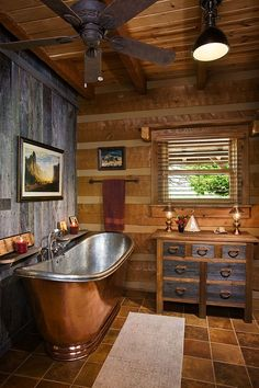 Beautiful bathroom with copper tub and vintage barn siding. Appalachian Log and Timber Homes