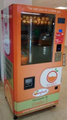 This vending machine squeezes fresh orange juice in front of you