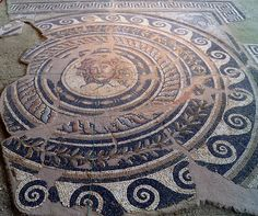 Mosaic floor from the Villa of Dionysos depicting Medusa's head in a circular frame, Archaeological Museum, Dion by Mt Olympus , Pieria Macedonia Greece