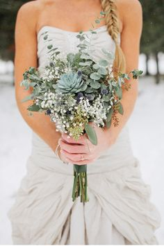 bridesmaid - babys breath, eucalyptus stems, white renaculus, with bright colored satin ribbon
