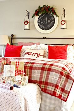 Master bedroom decorated for Christmas with plaid quilt and flannel bedding.