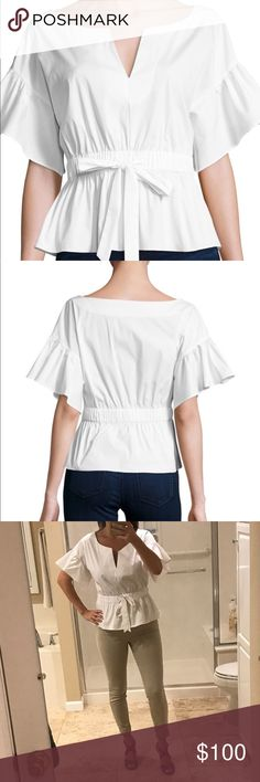 Milly Vivian White Cotton Top Stretch Poplin Sz L Like new stretch-poplin top.  No stains or signs of wear.  Still full price at retail $295 Split neckline. Ruffled half sleeves; dropped shoulders. Elasticized waist with self-tie drawstring. Slight peplum hem. Slipover style. Cotton/nylon/spandex. Made in USA of Spanish material. Milly Tops