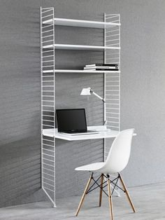 The String work desk is a beautiful and convenient addition to the String System collection – use it together with the 30 cm deep String panels. String System is a flexible shelving system that Swedish architect Nils Strinning designed in White Desk Shelves, White Desks, Shelf Desk, Office Shelf, Home Office, String Regal, String Shelf, String System, Shelving Systems