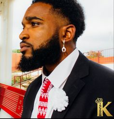Kingzdom tie and lapel. Email kingzdomllc@gmail.com for all inquiries!